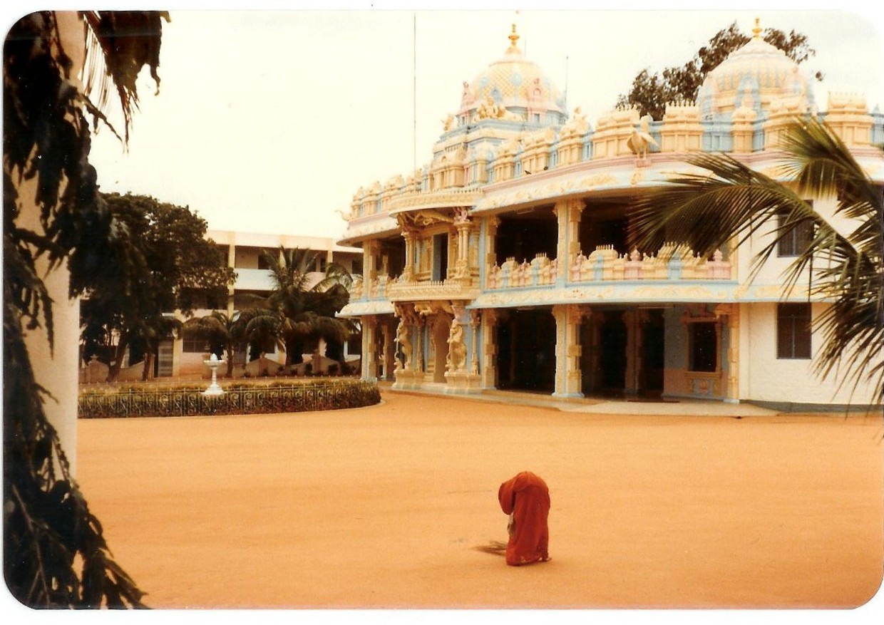 Sweeping the holy sand in front of the temple, August 1981
